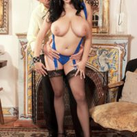 Dark haired MILF Shione Cooper flaunting huge boobs for nipple licking in nylons