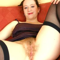 European amateur showing off hairy armpits before spreading hairy pussy on sofa