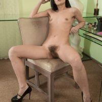 European brunette Gerda May baring tiny breasts and hairy vagina in high heels