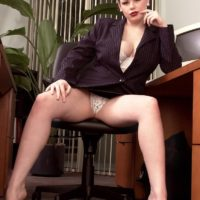 European MILF pornstar Desirae flashing big upskirt ass in office wearing high heels