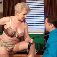 Granny pornstar Jewel seducing sex from younger man in office wearing tan nylons