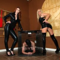 Latex attired Dommes Zoey and Kendra jerking off restrained and hooded male slave