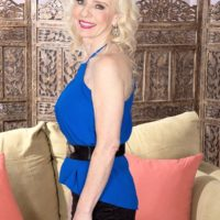 Leggy older blonde lady Cammille Austin prepping for sex with big black cock