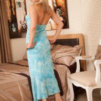 Mature blonde model showing off big tits and shaved vagina after doffing dress