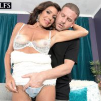 Mature brunette woman Layla LaMora having lingerie and panties stripped off