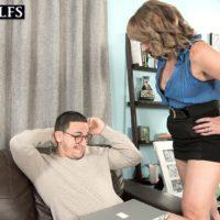MILF over 50 Catrina Costa seducing man in glasses wearing short skirt and heels