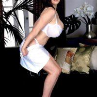 MILF pornstar Nicole Peters loosing huge boobs from white brassiere in lace panties