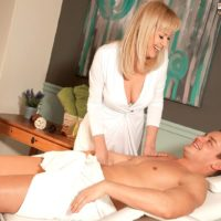Over 50 blonde MILF Arjana seducing younger stud in white stockings and garters