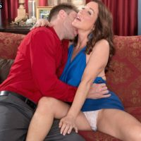 Over 50 MILF Rachel Steele freeing big tits before having cunt ate out on couch