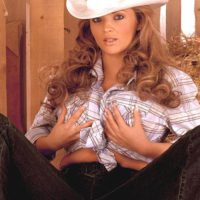 Solo girl Ines Cudna letting big tits loose in denim jeans and cowgirl hat in barn
