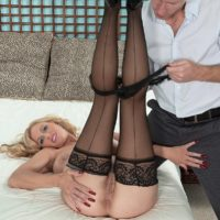 Big boobed blonde MILF Holly Claus giving large cock oral sex in black stockings