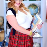 Blonde BBW solo girl Mya Blair posing in schoolgirl uniform, glasses and pigtails