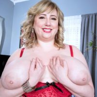 Blonde BBW solo model Laddie Lynn letting huge saggy boobs loose from lingerie