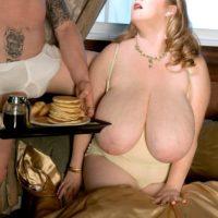 Blonde feeder Sapphire unleashing massive tits before giving handjob while eating