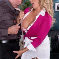 Blonde MILF pornstar Amber Lynn Bach giving titty fuck after being undressed