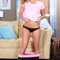 Blonde teen Kennedy Leigh releasing firm tits from black bra wearing black panties