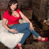 Brunette MILF Cat Bangles letting nice melons free wearing blue jeans and heels