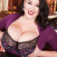 Brunette MILF Lila Payne revealing huge boobs in black garters and stockings