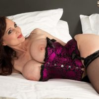 Brunette MILF over 50 Michaela O'Brilliant flaunting large tits before giving oral sex