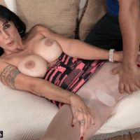 Brunette MILF over 50 Moreen Helm baring big tits for younger man in pantyhose