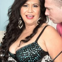 Brunette MILF over 50 Victoria Versaci exposing big butt while being undressed