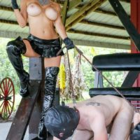 Busty blonde Domme Alexis Fawx leading 2 hooded male sex slaves on leashes