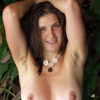 Busty European amateur displaying hairy underarms and beaver in the nude