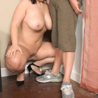 Curvy brunette MILF London Andrews baring hooters for nipple licking in jeans