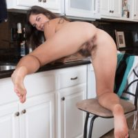 European amateur Katie Z showing off hairy armpits and all natural bush in kitchen