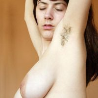 European solo girl playing with big natural tits before baring hairy armpits and bush