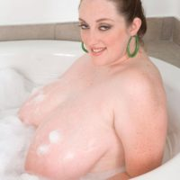 Fat solo girl Alice Webb letting massive wet tits hang free in the bathtub