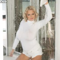 Hot blonde babe Katie Thornton soaping up huge all natural boobs in shower