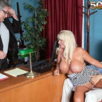 Mature blonde woman Annellise Croft flashing huge boobs in front of cuckold