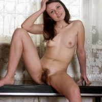 Naked amateur brunette solo girl showing off hairy pussy in bare feet on bench