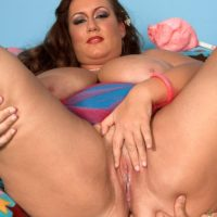 Obese female Rose Valentina masturbating while eating cotton candy