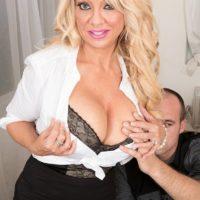Older blonde boss lady Bella Dea unleashing large tits before giving BJ in office