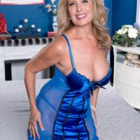 Older blonde lady Laura Layne baring big butt in stockings and heels for younger man