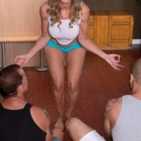 Older blonde yoga instructor Jenna Covelli sucking off student's big cocks in class