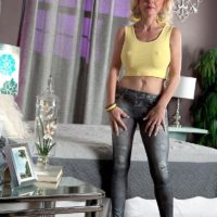 Over 50 blonde MILF Cammille Austin strip naked by black man before interracial sex