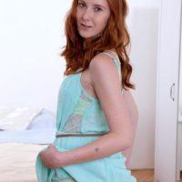 Redhead teen solo girl Linda Sweet modeling nude for tease photo shoot