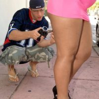 Black chick Luscious Louis flaunting big booty outdoors wearing micro skirt and heels