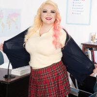 Blonde BBW Suzumi Wilder flashing her bra wearing socks and plaid skirt in office