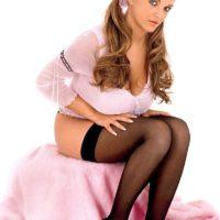 Blonde MILF Ines Cudna teasing in black stockings with hair in pigtails