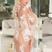 Blonde MILF Katie Thornton releasing huge fake tits from see thru lingerie in heels
