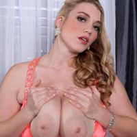 Blonde MILF Melissa Manning flashing up skirt panties before exposing large tits