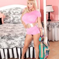 Blonde MILF Venera unleashing massive tits attired in high heeled shoes on bed