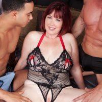 Busty redhead MILF Heather Barron fucking 2 large cocks during MMF threesome