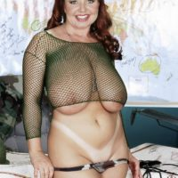 Chubby redhead MILF Cherry Brady exposing huge hooters in military fatigues