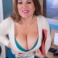 Dirty blonde MILF Janessa Loren letting hooters loose from bra in home office