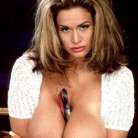 Famous MILF pornstar Tawny Peaks unleashing monster tits wearing faded jeans